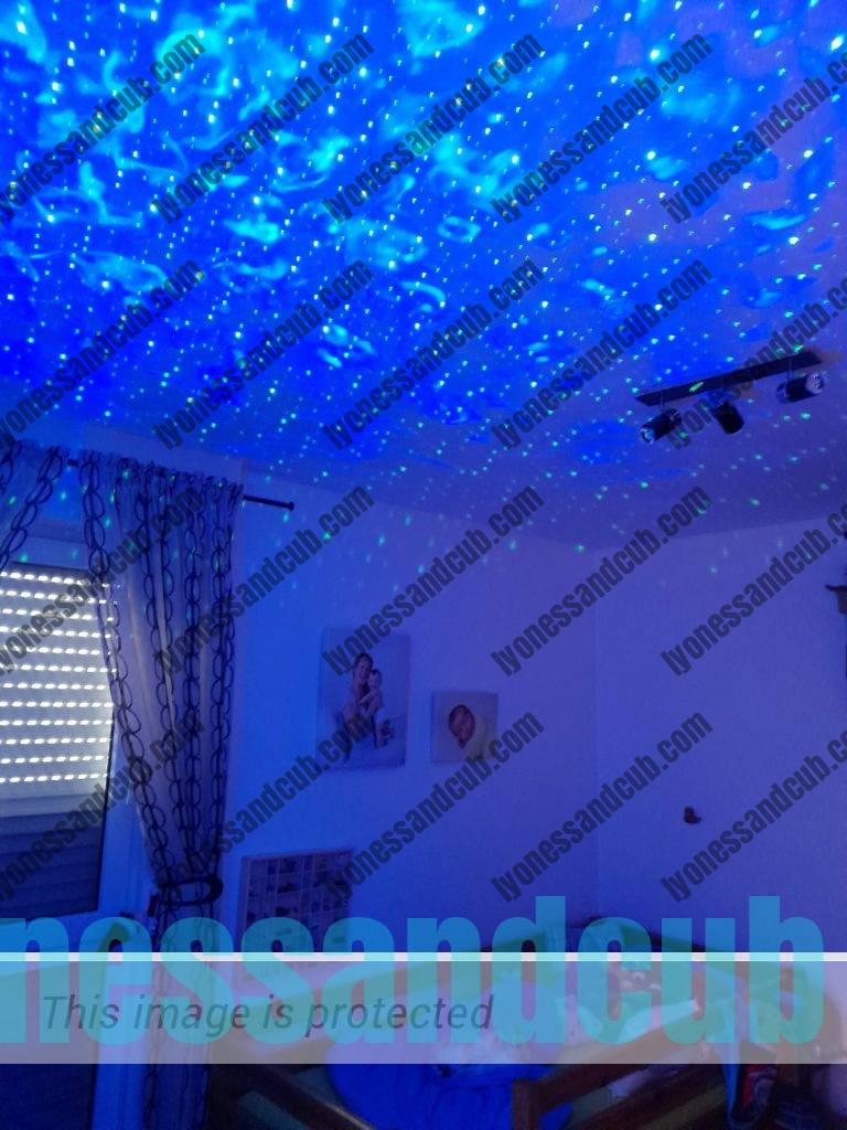 LED Star Light Projector in action, making room blue and starry