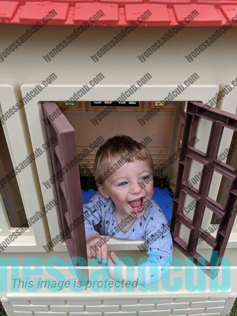 toddler in Little Tikes playhouse