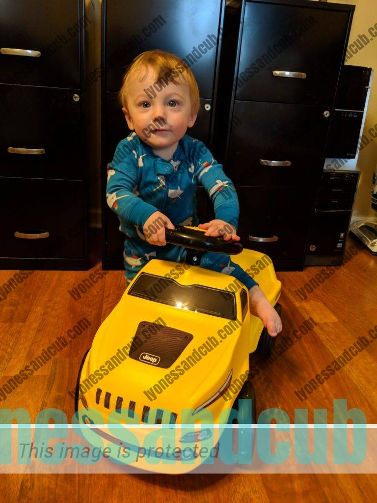 proud toddler on Jeep Cherokee Ride-on Push Car