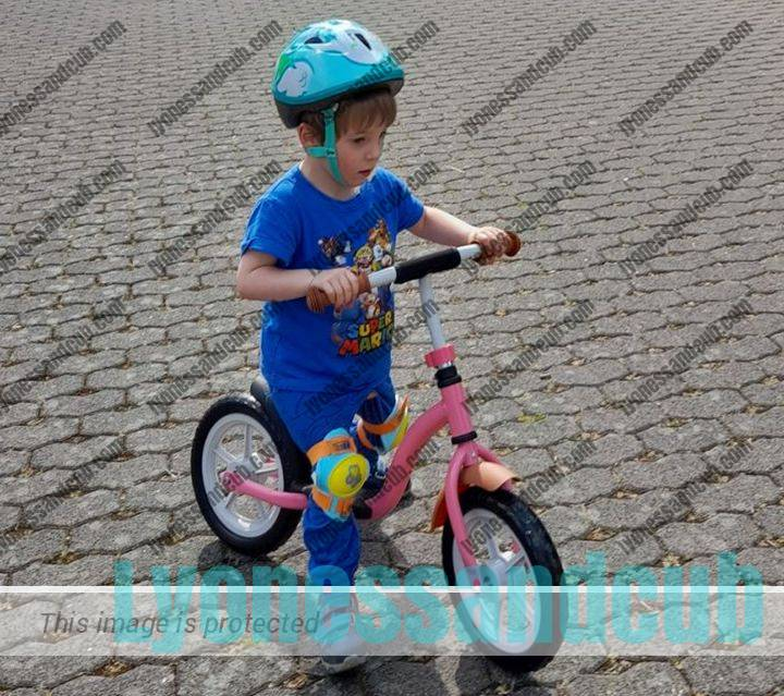 3-year-old riding on balancing bike from ALDI