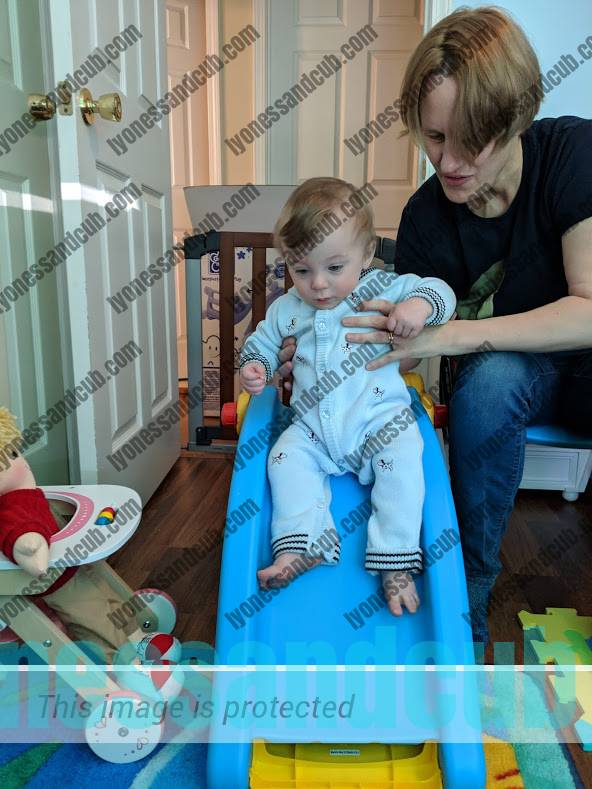 one-year-old with mommy, sliding down his 2-in-1 slide and rocker