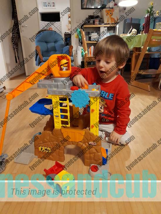 toddler playing with Little People Construction Set