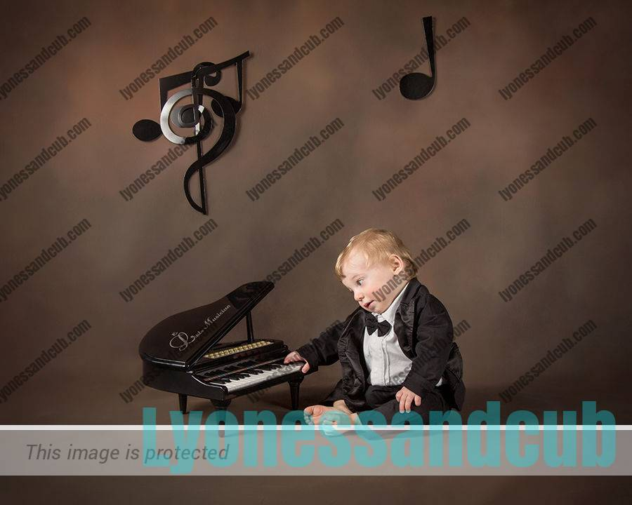 one-year-old boy playing toy piano