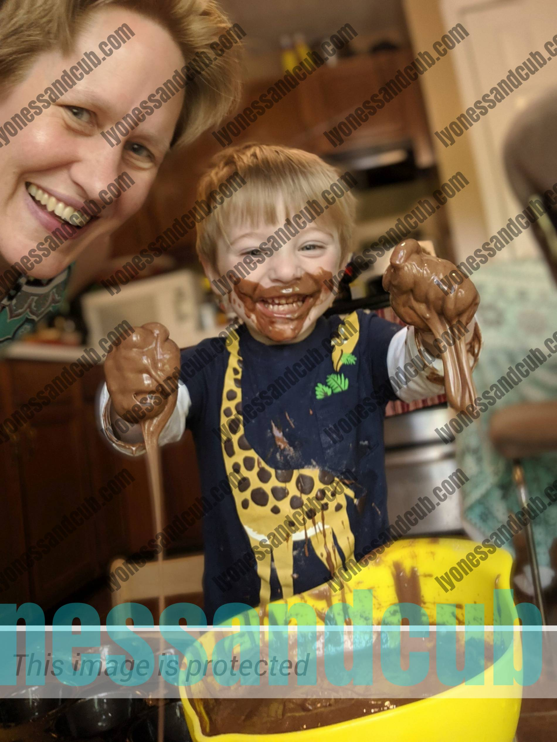 messy toddler and mom in the kitchen, baking brownies