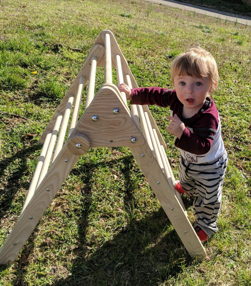 toddler at Pikler triangle