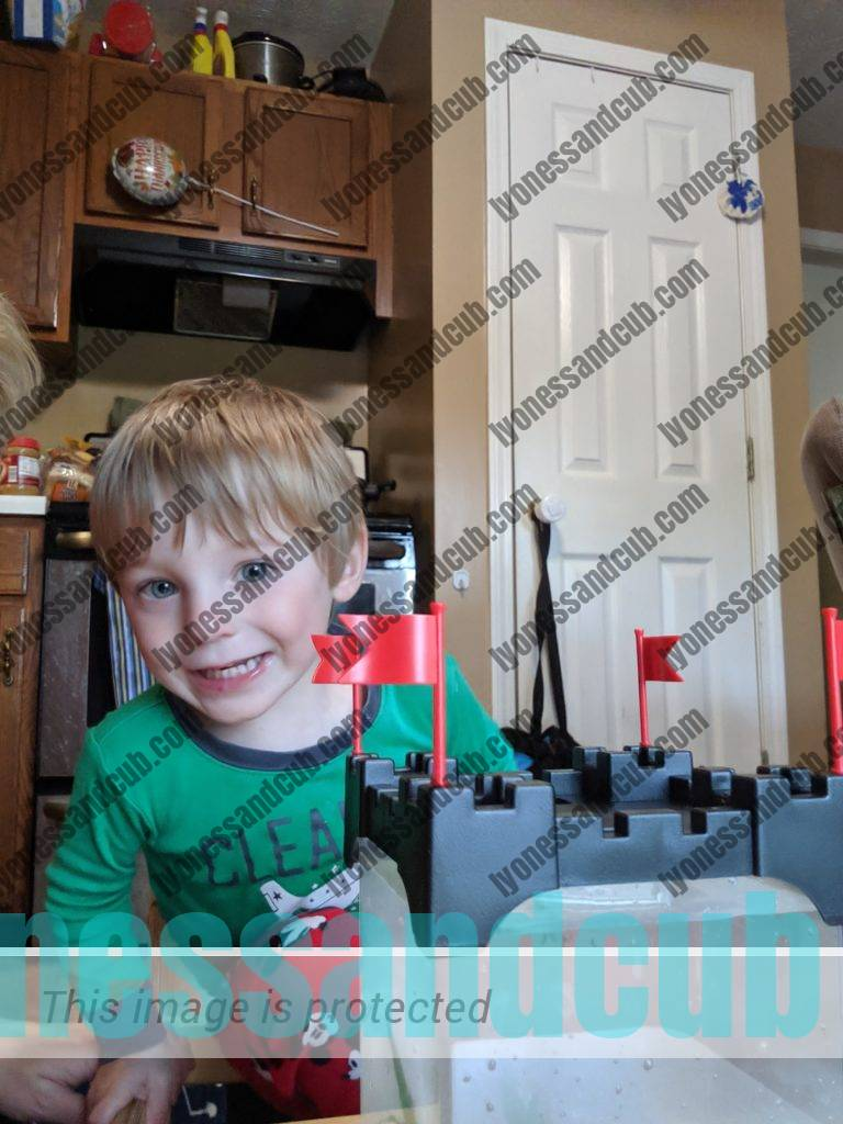 toddler proud of his Aqueon Betta Castle Kit, raising tadpoles