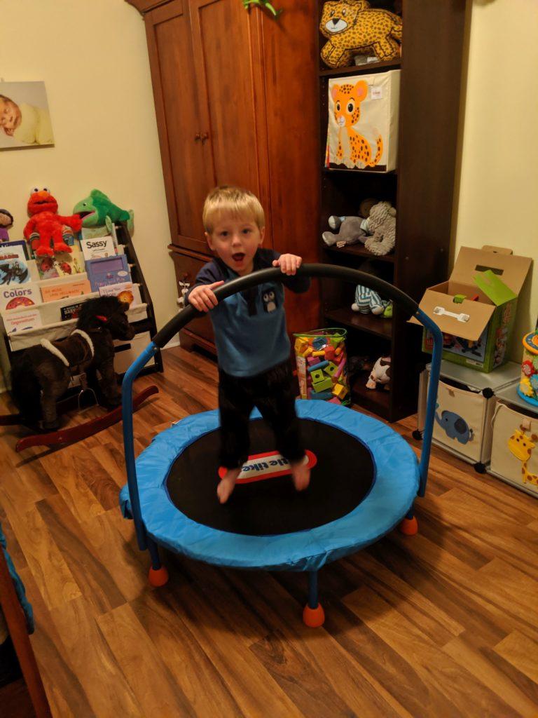 toddler jumping on indoor trampoline