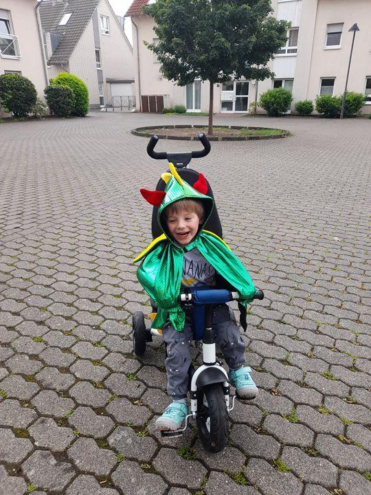 toddler wearing Great Pretenders Dragon Cape