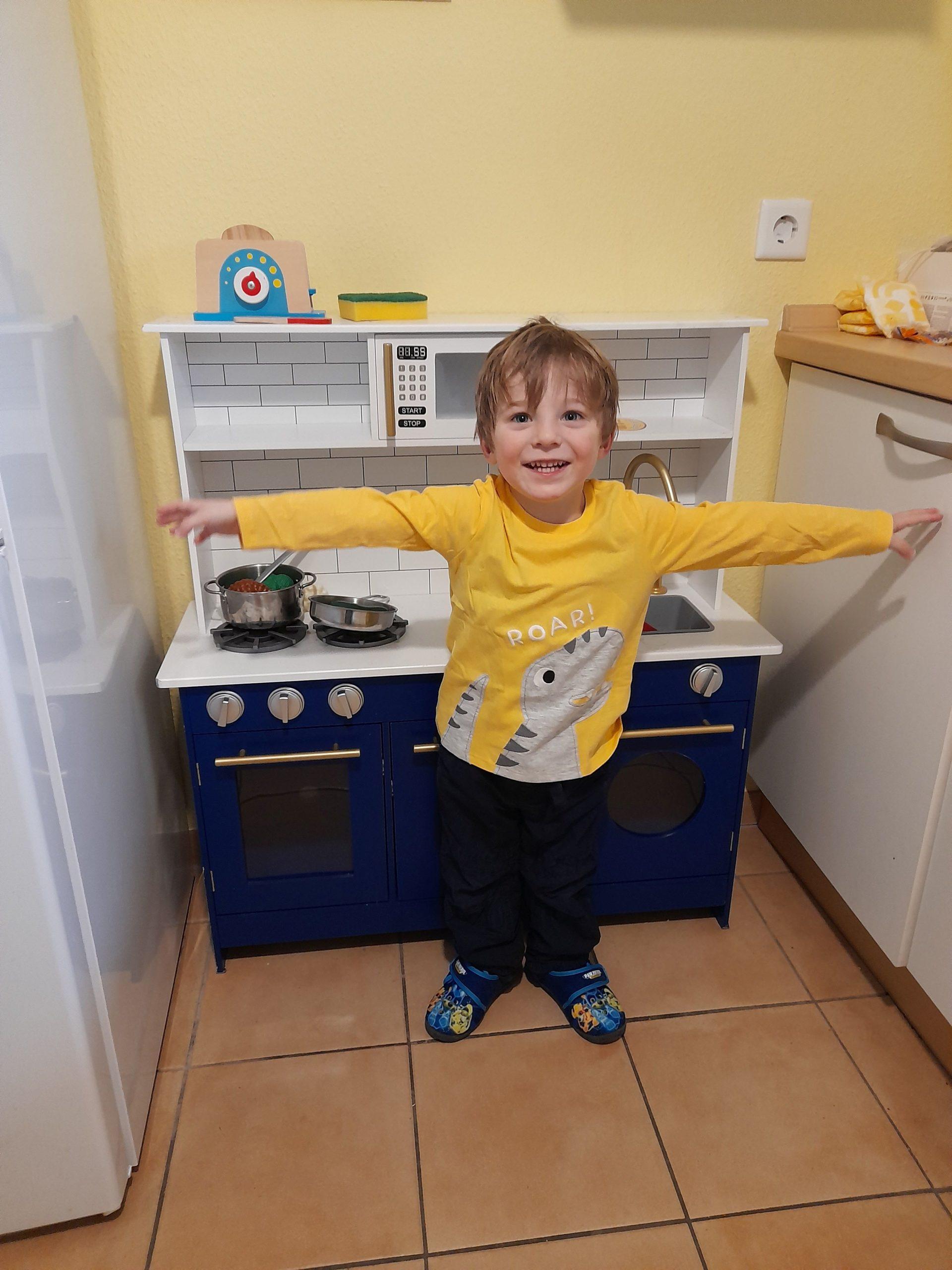 2.5-year-old in toy kitchen