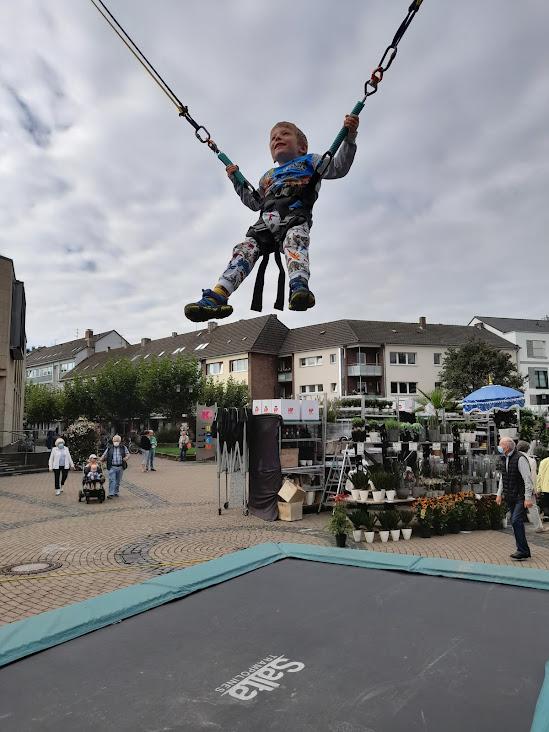 kid on jumping spider trampoline